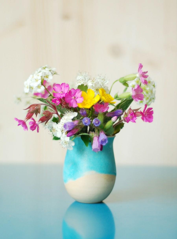 sige det med blomster